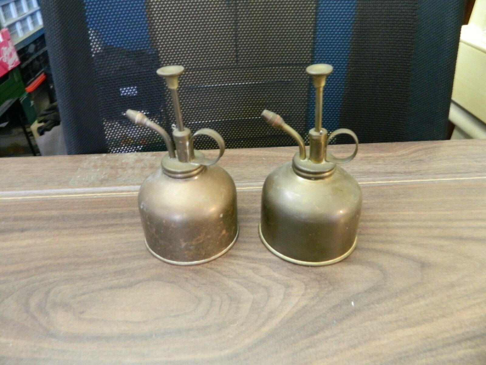 pair of vintage brass orchid watering spray cans