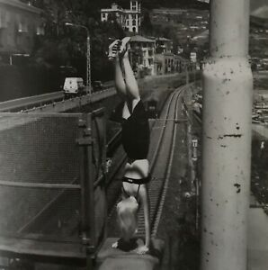 Helmut-Newton-woman-doing-handstand-Bordighera-Italy-1996-Matted-PHOTOLITHO