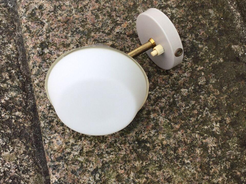 Væglampe, Designer
