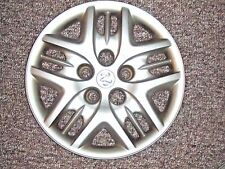 ONE WHEEL COVER FROM 2003 DODGE CARAVAN BOLT ON PLASTIC ORIGINAL OEM COVERS