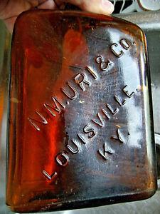 N.M. URI & Co.,  LOUISVILLE, KY.   whiskey bottle(empty) embossed label