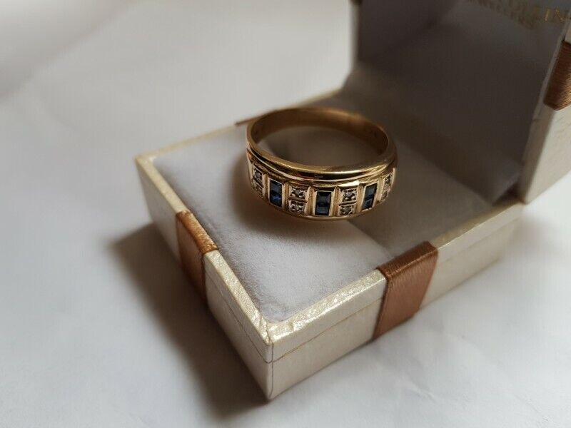A141 9k Gold Sapphire and Diamond Ring