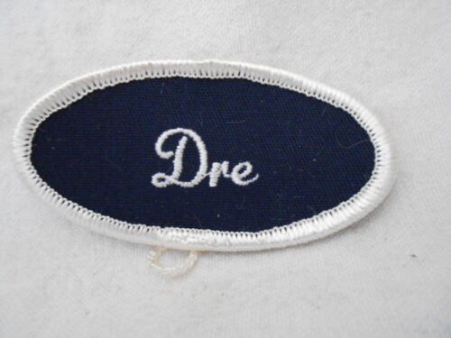 DRE USED EMBROIDERED  SEW ON NAME PATCH TAG OVAL WHITE ON BLACK