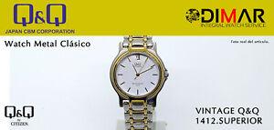 Vintage Uhren Q&Q Top 1412. Serie Metall WR.30m. Ø. Caja. 36mm. 1 Micron