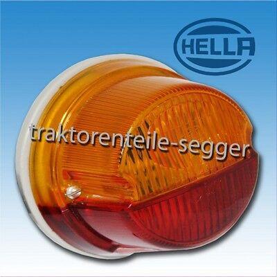 Hella Blink und Rückleuchte IHC rund  mit Halter Traktor Schlepper