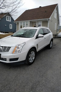 2015 Cadillac srx in outstanding condition.