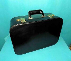 valise ancienne en cuir noir porté main