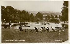Hastings. Alexandra Park. Children feeding pigeons boats lake RP   JE.429