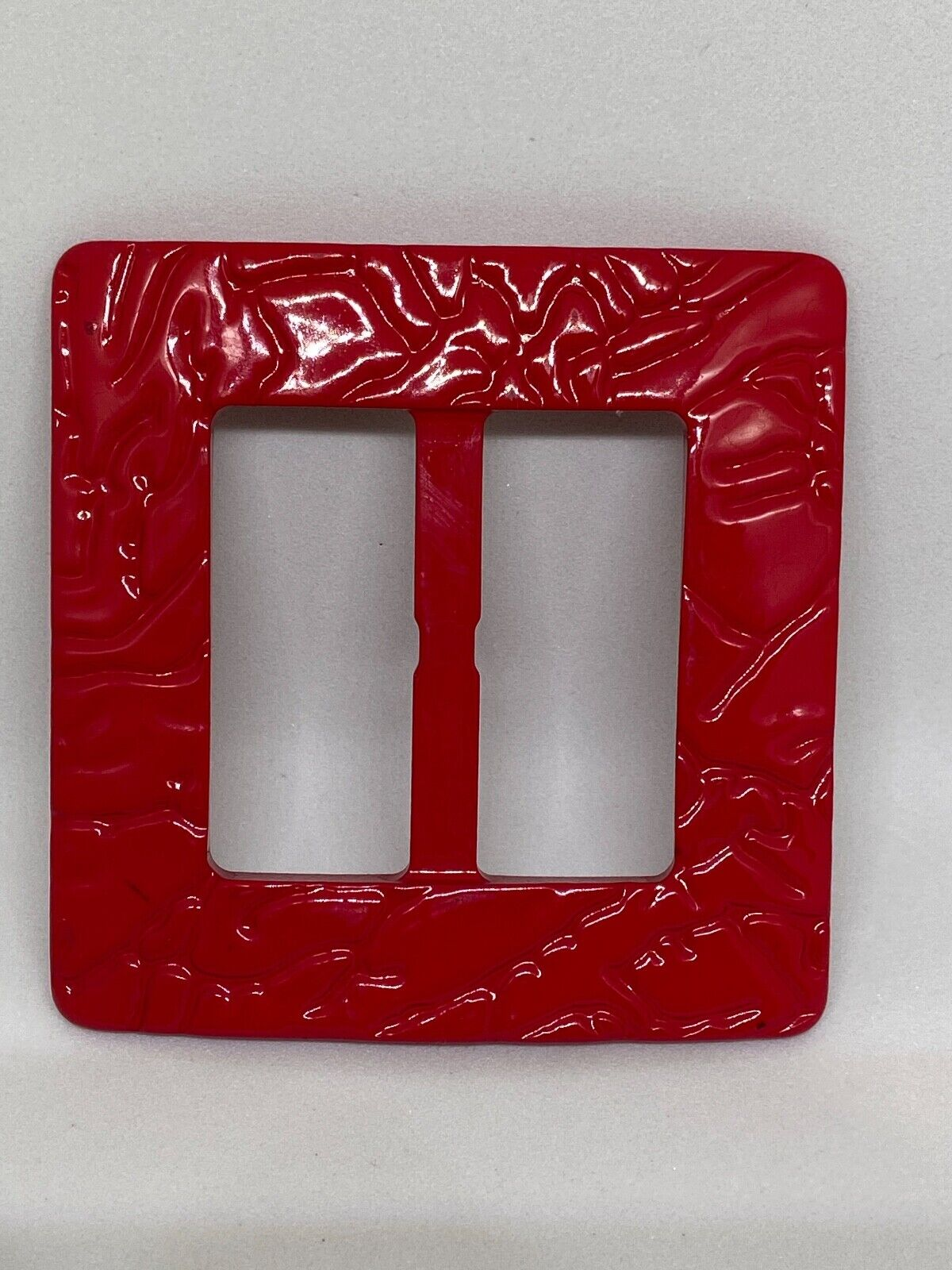Woman`s red, plastic, Italy, belt buckle