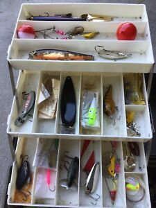 Old Vintage Fishing Tackle Box Loaded with lures and tackle.