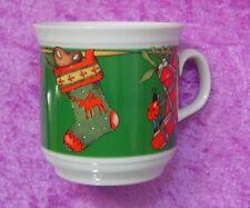 Feinkost Käfer Sammel-Tasse: Weihnachts-Socken auf Leine
