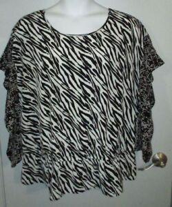 c93ce751a7b Lane Bryant Peplem Blouse Size 18 20 Black   White Animal Print ...