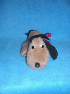 Small-Stuffed-Dog-with-Floppy-Ears-and-Red-Ribbon