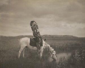 Oglala-warrior-Red-Hawk-sits-on-a-horse-in-the-Badlands-South-Dakota-Photo-Print