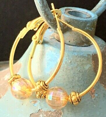Gold earrings in fine gold small creoles with white boho glass bead with faceted