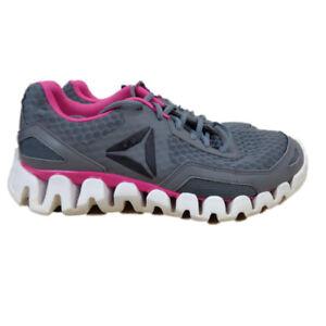 on sale 46f55 918b0 Image is loading Reebok-Zig-Evolution-Women-039-s-Running-Shoes-