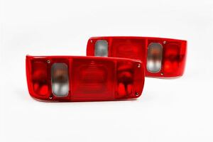 Pair of HELLA 95mm Round Red Rear Reflector