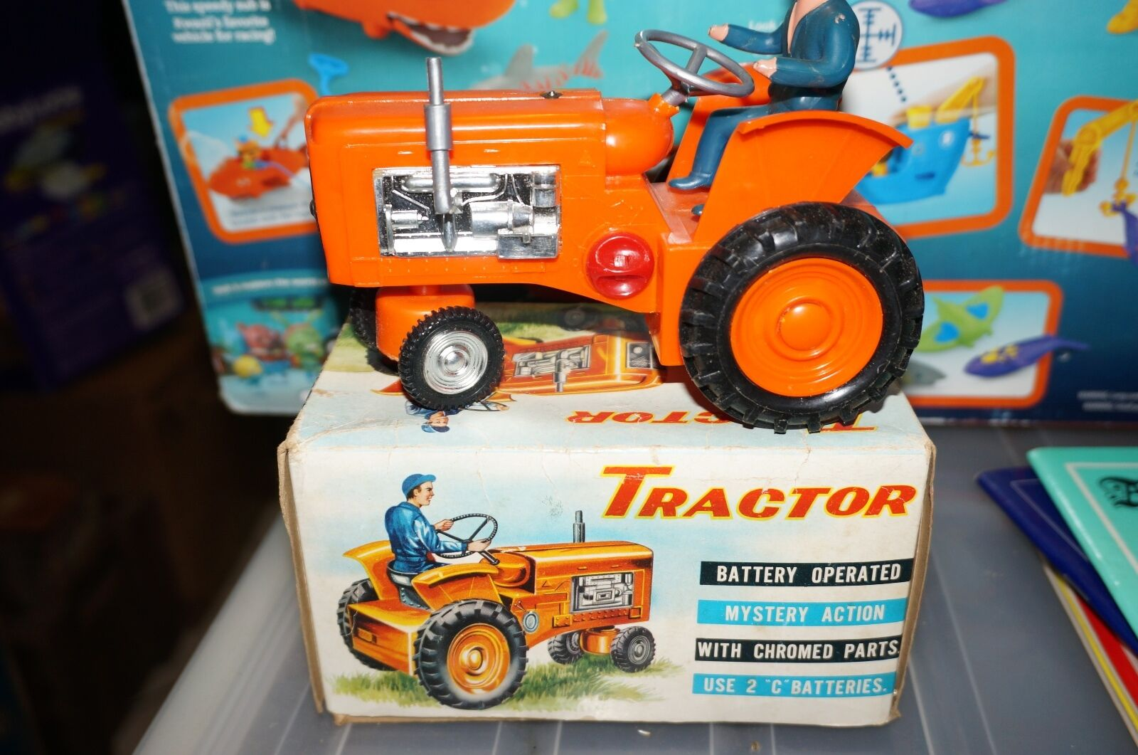 Toy Tractor made in Hong Kong by MIC takes 2 x C size batteries