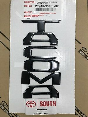 Tacoma Raised Flat Black Tailgate Emblems Insert   2018-19    OEM PT948-35181-02
