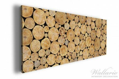 Wallario Leinwandbild 50 x 125 Holzstapel rund holz gehackt stapel rund braun