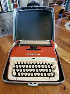 Vintage Smith Corona Galaxie orange typewriter with case