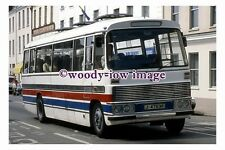 pu1024 - Holiday Coach Tours reg no J47636 at St Helier - photograph