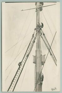 RPPC-Man-w-Gilligan-Bucket-Hat-Shimmies-Up-Mast-Another-Climbs-Rope-Ladder-c1937