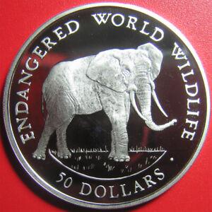 1990-COOK-ISLANDS-50-SILVER-PROOF-AFRICAN-ELEPHANT-ENDANGERED-WILDLIFE-CROWN