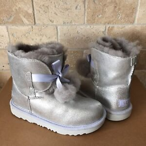325ec279d66 Details about UGG GITA METALLIC SILVER POM POM BOW BOOTS SIZE 3 KIDS YOUTH  GIRL fits WOMENS 5