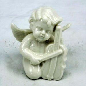 Decorative Shiny White Ceramic Cherub Playing A Violin