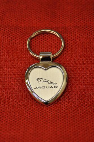CG3081 $9.95 EACH.TWO-TONED SMALLER HEART SHAPED KEY CHAIN.SILVER W// JAGUAR LOGO