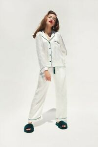 White-pajama-pants-with-navy-blue-bow-string-and-trim