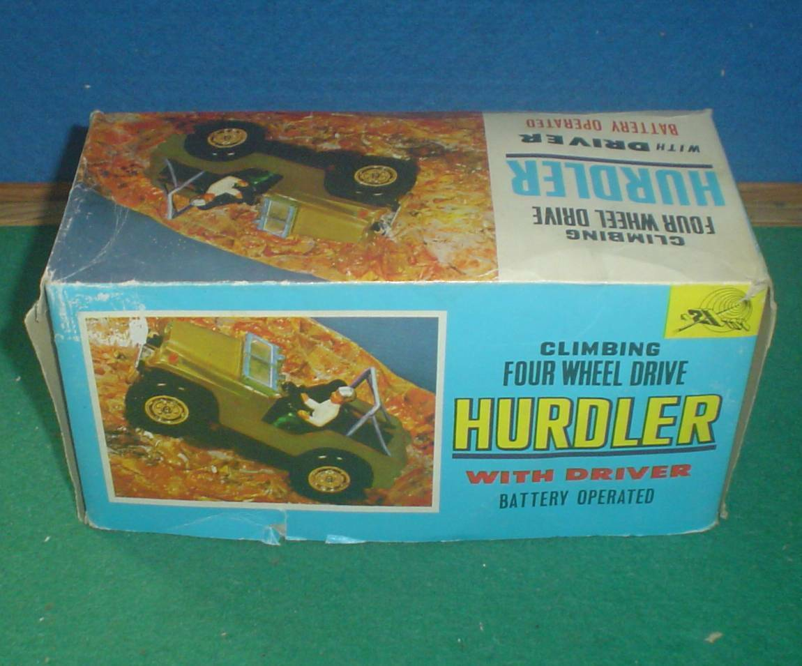 21st CENTURY TOYS 1960's BATTERY OPERATED CLIMBING JEEP HURDLER 1 25 SCALE BOXED
