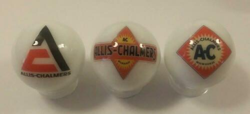 A Lot of 3 Allis Chalmers Tractor Logos Advertising Glass Marbles