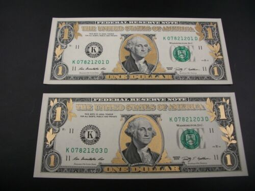 Two Uncirculated Colorized Gold One Dollar Bills