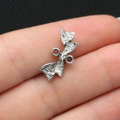 SC4228 8 Bow Connector Charms Antique Silver Tone