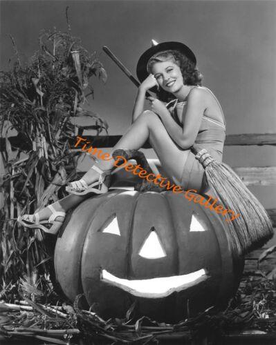 Vintage Photo Print 1940s Halloween Pin-up Girl Sitting on a Pumpkin