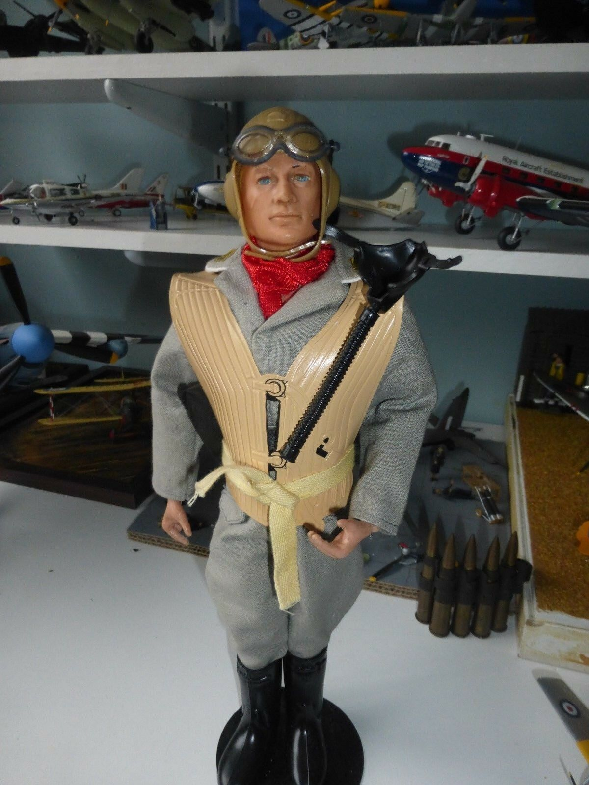 Vintage Action Man with 40th German Luftwaffe pilot uniform with stand.