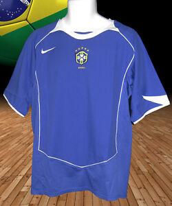 Dettagli su NEW Vintage NIKE BRASILE BRASIL CALCIO-SHIRT AWAY BLU 2004/5 XL- mostra il titolo originale
