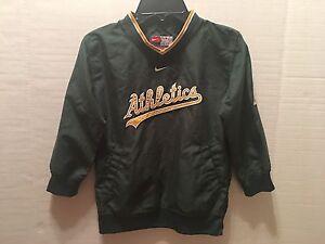 be566587fb A imagem está carregando Oakland-A-039-s-Athletics-Nike-pulover-Vento-