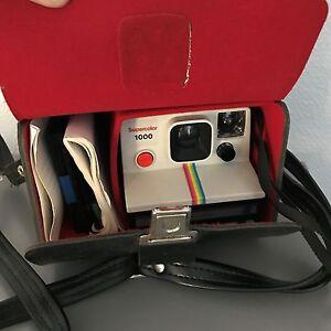 POLAROID 1000 land camera vintage appareil photo avec sac cuir - France - État : Occasion: Objet ayant été utilisé. Objet présentant quelques marques d'usure superficielle, entirement opérationnel et fonctionnant correctement. Il peut s'agir d'un modle de démonstration ou d'un objet retourné en magasin aprs une - France