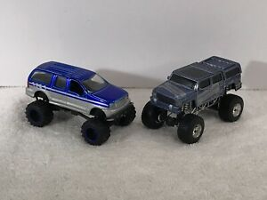 JADA TOYS 4x4 FORD EXCURSION & SMART BEAN HUMMER WITH PULL BACK & RELEASE ACTION
