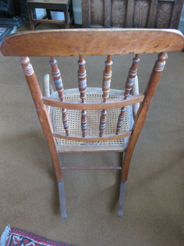 A beautiful crafted antique wood rocking chair with fabulous detailing & patina