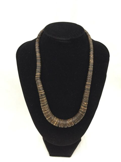 WOODEN BEADED NECKLACE-RINGS THAT GRADUALLY INCREASE IN SIZE-METAL CLASP-18 INCH