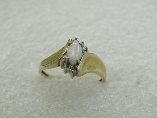 6. Appx 1.58 Gr. 10kt Aquamarine Diamond Bypass Ring Sz