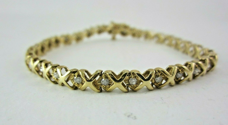 BEAUTIFUL LADIES 10K YELLOW gold DIAMOND TENNIS BRACELET;  .6CT. 7.8G