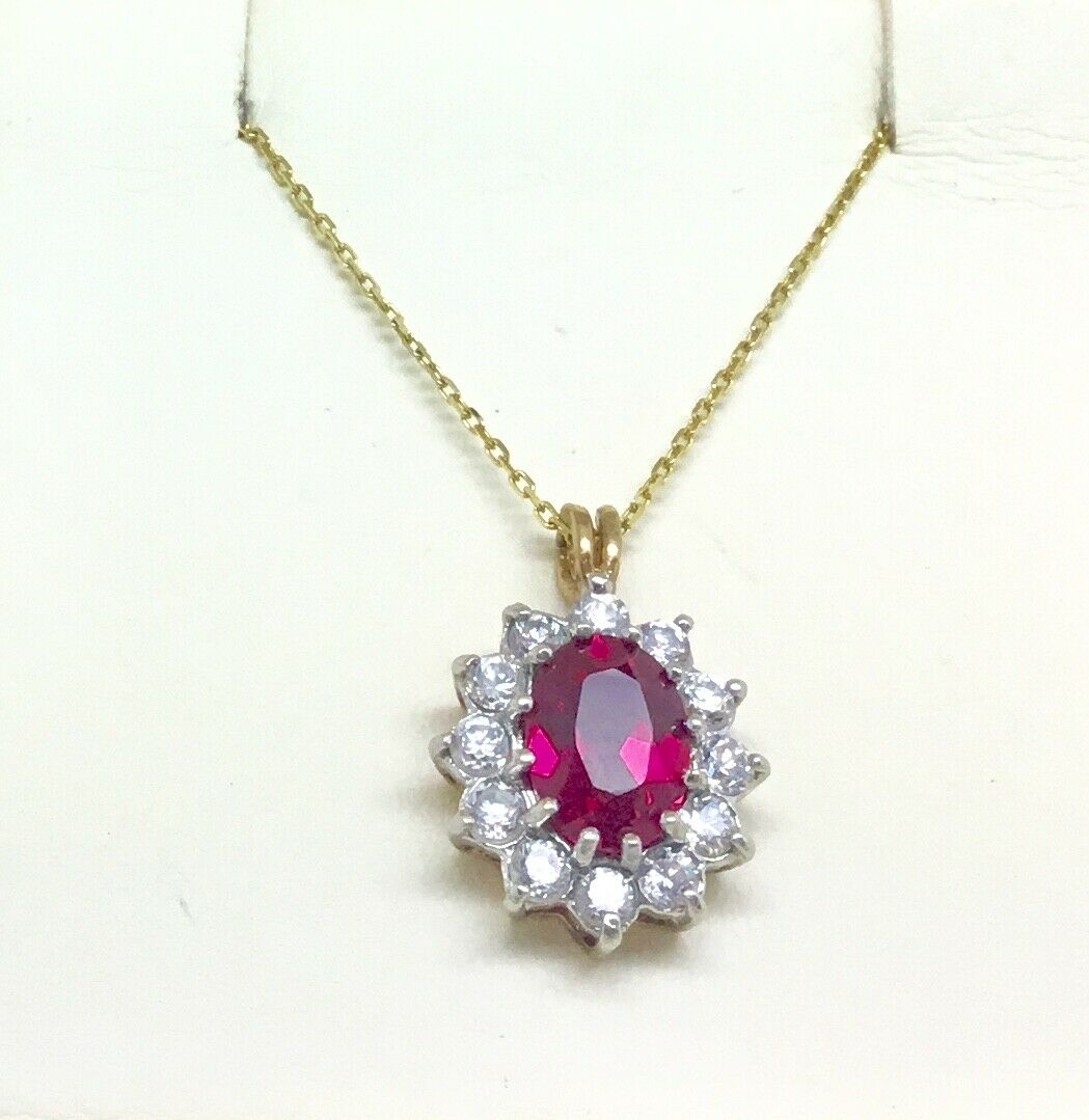 9ct gold pendant set with Ruby & White Cubic Zirconia stones