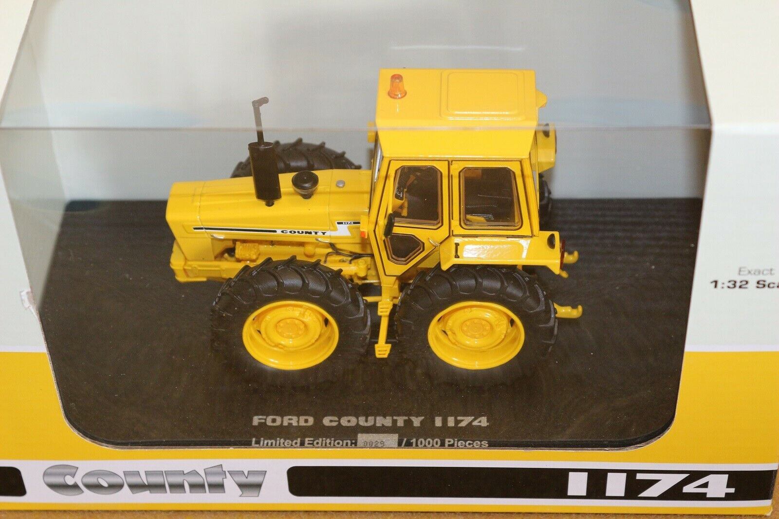 UH6212 1 32 Ford County 1174 Industrial Yellow Tractor