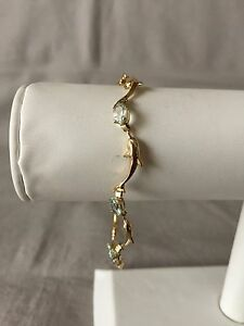 Aquamarine-Dolphin-Bracelet-7-1-2-034-Long-14K-Yellow-Gold