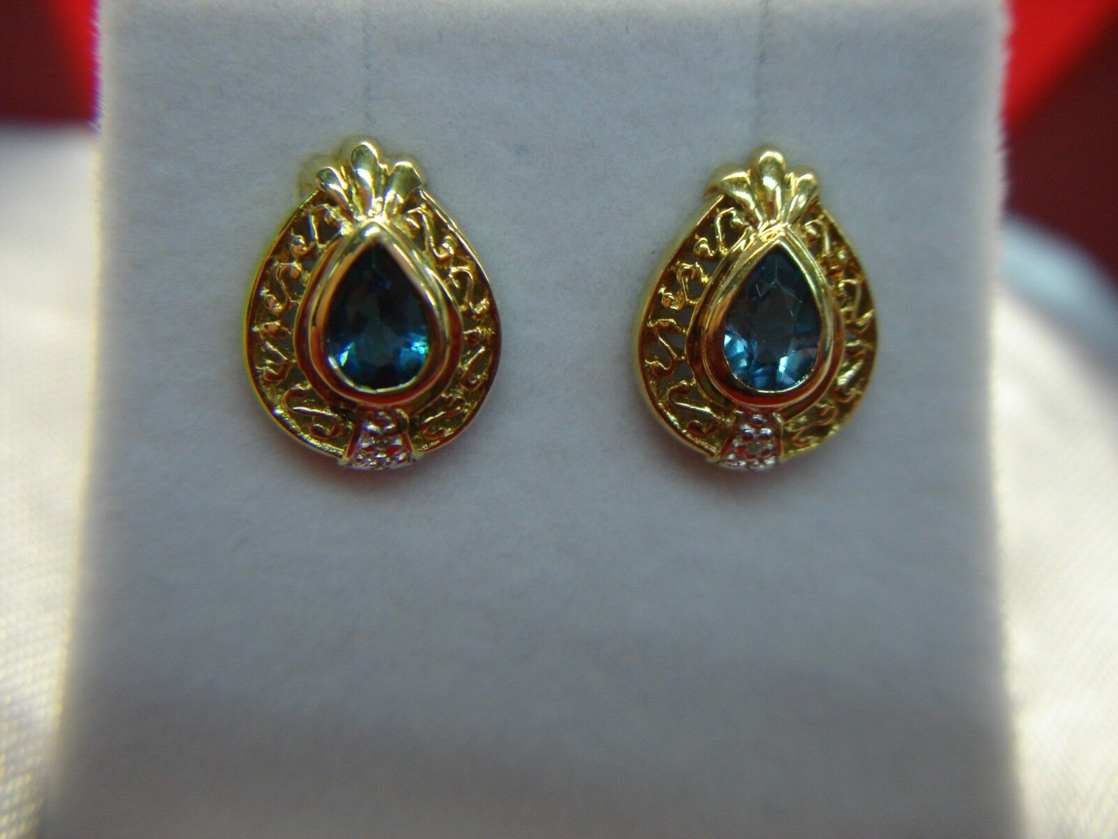 14K YELLOW gold STUDS WITH PEAR SHAPED blueE TOPAZ & ACCENT DIAMONDS - CUTE